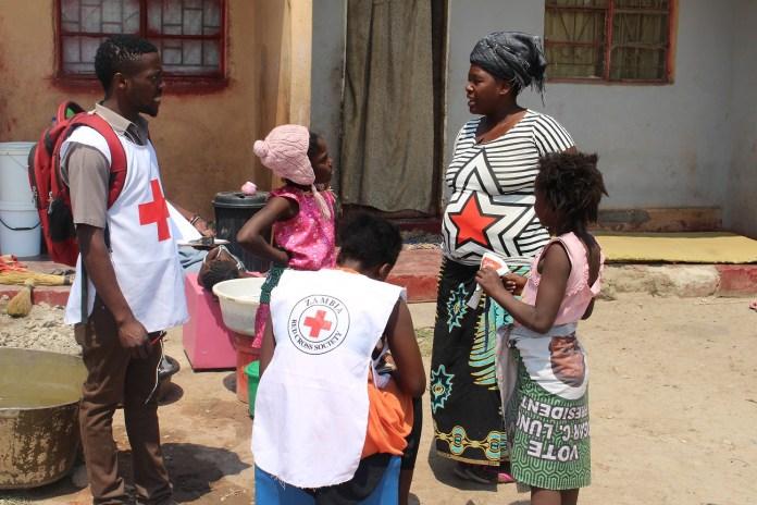 Red-Cross-Volunteers-conducting-Door-to-Door-Awareness-of-Measles-and-Rubella-Vaccination-Campaign-in-Lusaka