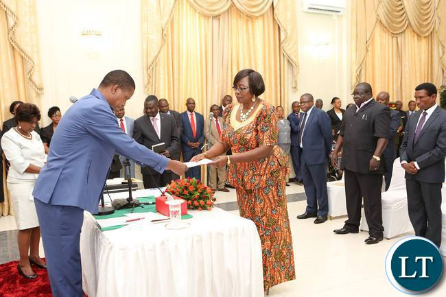 President Edgar Lungu receives an affidavit of Oath from Hon Emirene Kabanshi, Minister of Minister of Community Development and Social Services during the Swearing -In-Ceremony at State House on 29th September, 2016. (Picture by Eddie Mwanaleza)