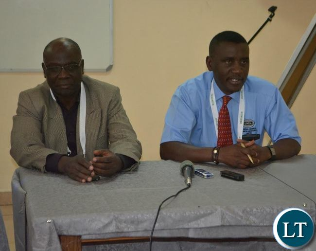 Universal Mining and Chemical Industries Limited (UMCIL) executive technical director Julius Kaoma (left) flanked by company sales manager Benjamin Belemu (right) during a media briefing in Livingstone. This was at the end of the three-day International Conference on Infrastructure Development and Investment Strategies for Africa