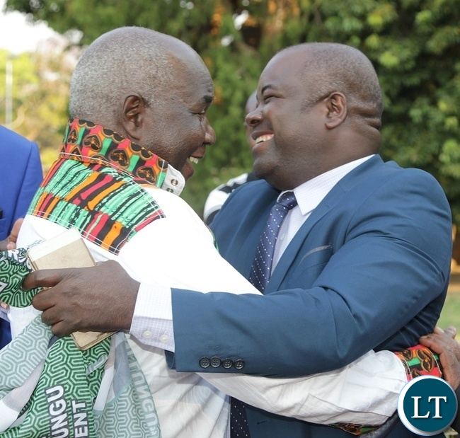 Former Deputy Minister of Works and Supply,Col. Mpanji Kaunda is welcomed by Deputy Minister of Youth and Sports, Ronald Chitotela at the Luncheon State House.