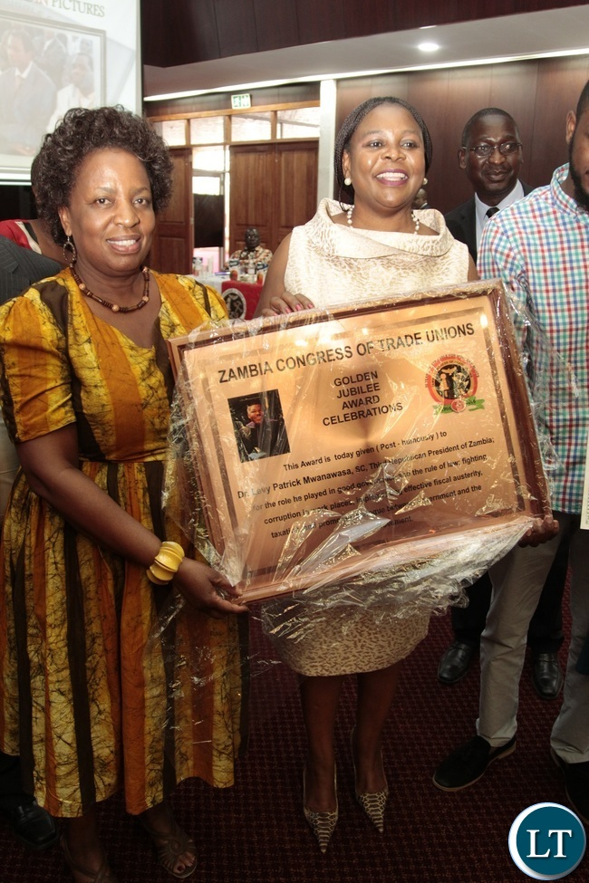 Minister of Labour Joyce Nonde presents the award to Dr. Maureen Mwanawasa on behalf of her late Husband Patrick Mwanawasa (Post-Humously) during Zambia Congress Trade Union Golden jubilee award Celebration at Mulungushi Conference Center