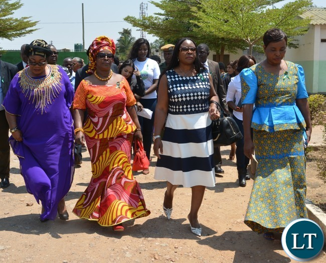 First Lady Esther Lungu(second left), Second Former First Lady Vera Tembo Chiluba(l) ,Third Former First Lady Maureen Mwanawasa(second right) and North mead Primary School Headmistress Sylvia Mulyata(r) during Giacomo Global Hand Washing Day at North mead Primary School