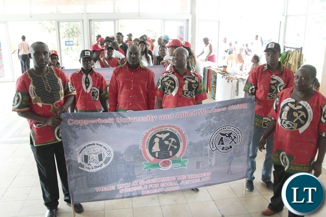 Unioned workers march during Zambia Congress Trade Union Golden jubilee Celebration at Mulungushi Conference Center