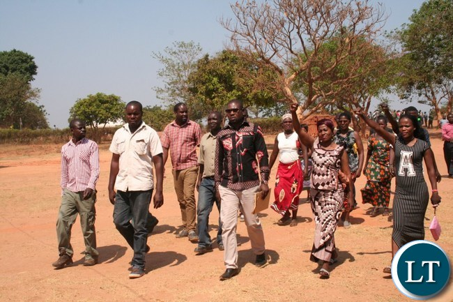 PATRIOTIC Front (PF) candidate for Kalumbila council chairperson Slavian Bulaya (middle in glasses) with his agents walking towards filling in Nomination papers at Mwajimambwe school on Thursday in Kalumbila distric