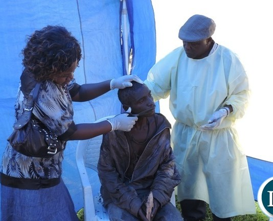 Mental patients being bathed and clothed by Nurses and student nurses from Livingstone General Hospital at the Livingstone Civic Centre in Livingstone