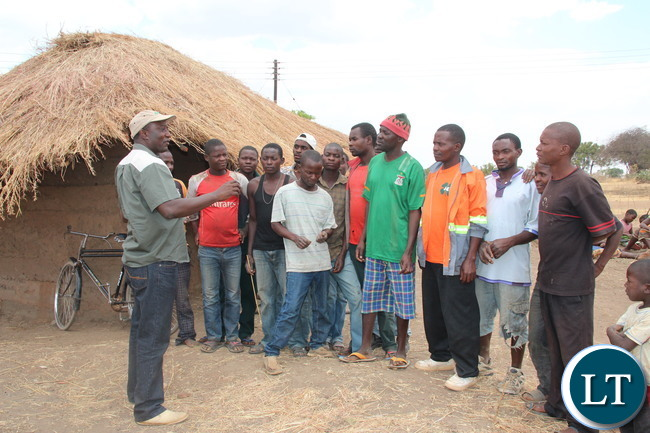 Zesco spokesperson Henry Kapata talking to Luangeni villagein Chipata District In Eastern Province against vandalism after electrifyinggrass thatched houses in the village. A total of 391 thatched houses are beingelectrified in. Picture by Jean Mandela