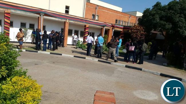 ZNBC workers loitering outside their offices