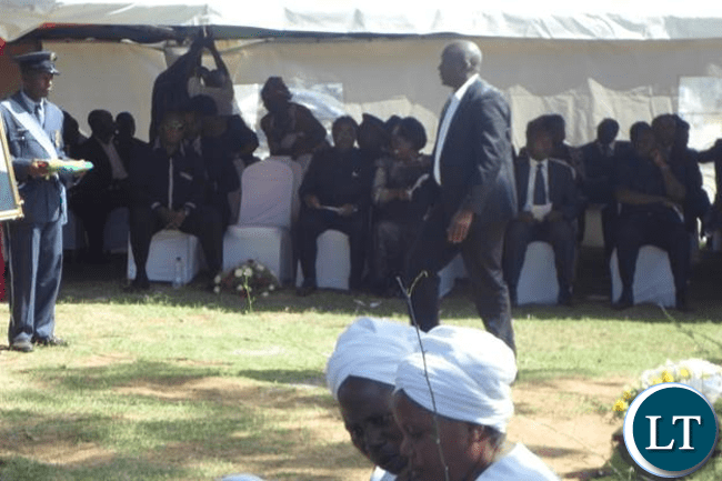 The current Inspector General of Police-Mr Kakoma Kanganja- collecting wreaths before laying them at the grave of his brother-Dr J L Kanganja-Picture by Aubrey K Chindefu