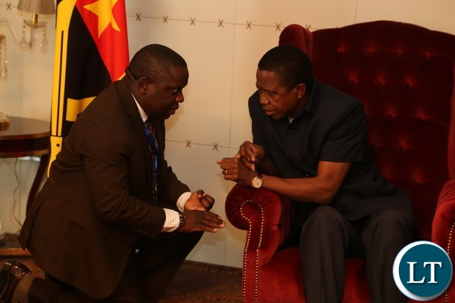 President Lungu talks to minister of foreign affairs Harry Kalaba on arrival at Luanda international Airpot in Angola 26-10-2016