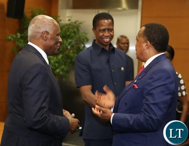 Congo Brazavil President Denis Sassou Ngwesso talks to Angolan President Eduardo dos antos while President Lungu listerns during the grate lakes summit in Luanda Angola 26-10-2016.