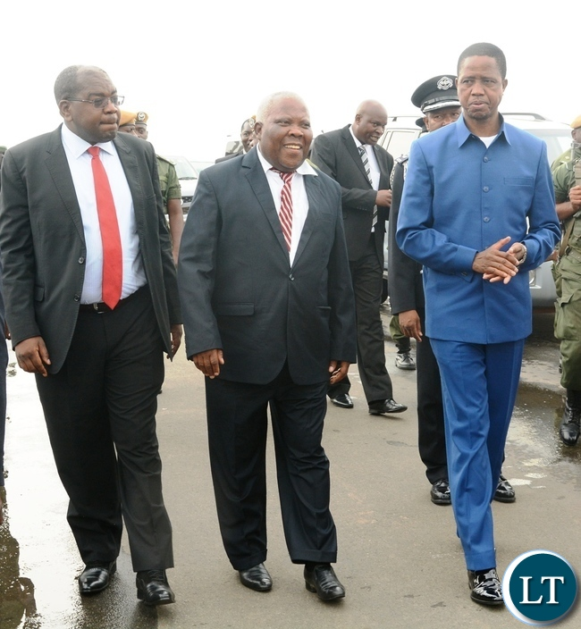 President Edgar Lungu(r) before departure for Morocco with Presidential Affairs Minister Freedom Sikazwe(c) and Health Minister Chitalu Chilufya(l) at Kenneth Kaunda International Airport in Lusaka
