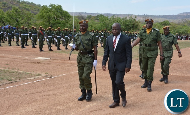 Minister of Home Affairs Stephen Kampyongo inspecting guard of Graduates Paramilitary Parade during the 2015-2016 Pass out Parade in Geoffrey Mukuma Training School or called Sondela in Kafue District