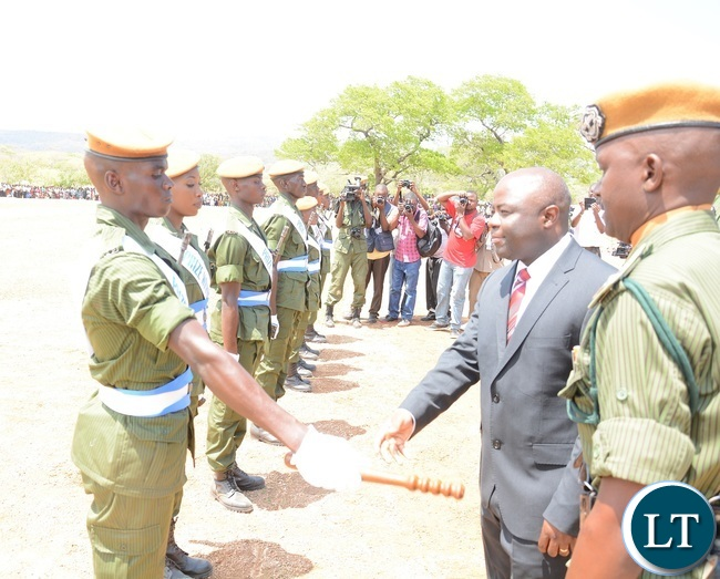 Minister of Home Affairs Stephen Kampyongo Congratulating Recruits Constables during the 2015-2016 Pass out Parade in Geoffrey Mukuma Training School or called Sondela in Kafue District
