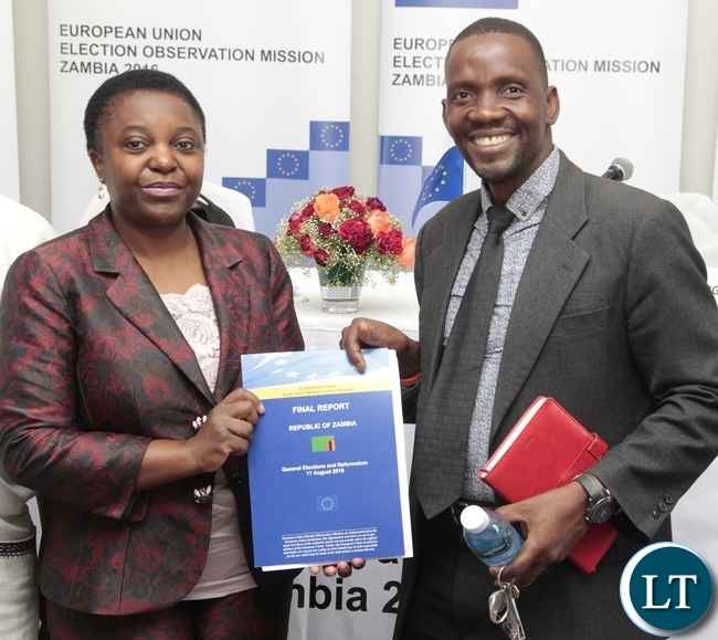 European Union Election Observation Mission in Zambia Chief Observer Cecilia Kashetu Kyange with McDonald Chipenzi shows off the General Elections and Referendum Final Report at Intercontinental Hotel shortly briefing