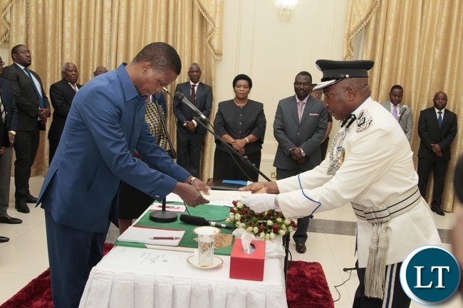 President Edgar Lungu receive latter of Oath from Newly appointed Northern Province Police Commissioner Richard Mweene at State House yesterday 14-10-2016. Picture by ROYD SIBAJENE/ZANIS