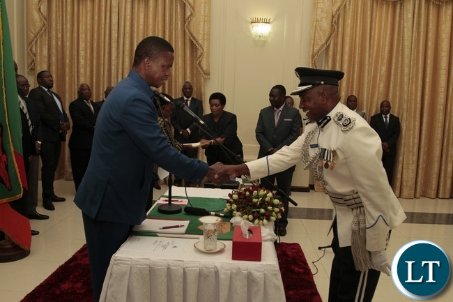 President Edgar Lungu congratulates Newly appointed Northern Province Police Commissioner Richard Mweene at State House