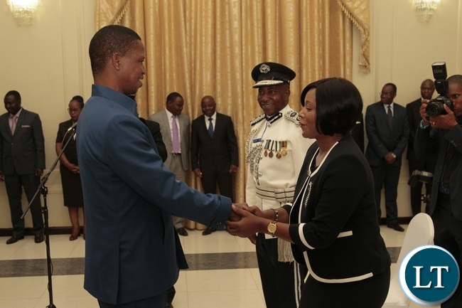President Edgar Lungu congratulates Newly appointed Minister of Information Kampamba Mulenga whilst Newly appointed Northern Province Police Commissioner Richard Mweene looks on at State House