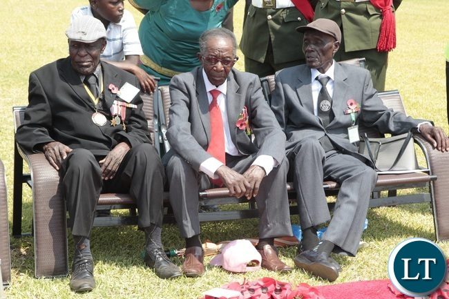 War Veterans Edward Lungu 88 years old, Simon Simwiinga 92 years old (C) and Jaston Khosa 92 years Old following the proceedings during the Remembrance Day at the National Cenotaph yesterday 13-11-2016. Picture by ROYD SIBAJENE/ZANIS