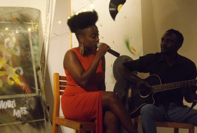 Chembo performing with guitarist Stanley