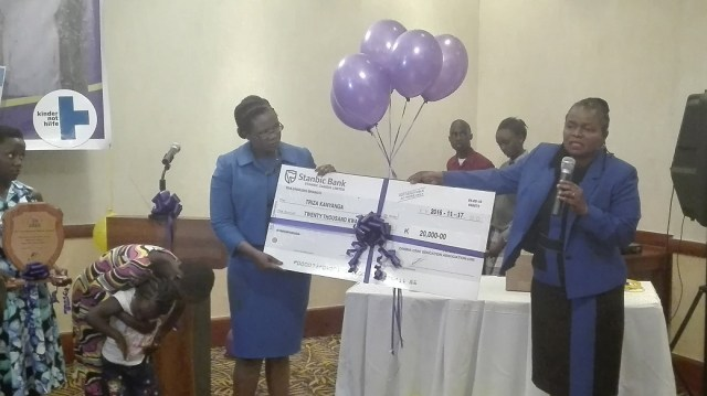 LAZ president Linda kasonde (right) and ZCEA executive director Judith Mulenga presenting the K20000 cheque