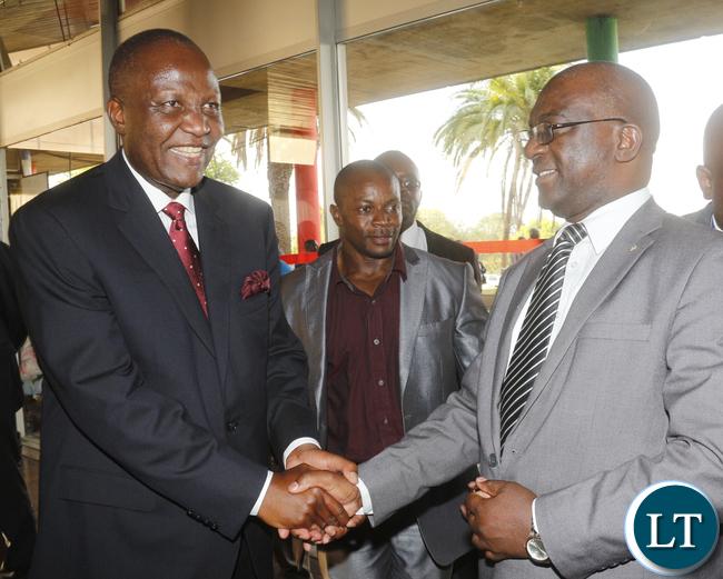 Finance Minister Felix Mutati interacting with Zambia Daily Mail Managing Director Nebat Mbewe.