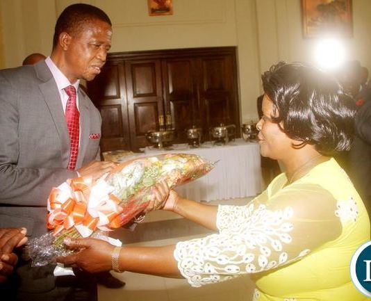President Edgar Chagwa Lungu (L) receives a bouquet of flowers from First Lady Esther Lungu (R) on the occasion to mark the President's 60th birthday. The commemoration was organised by well wishers and State House members of staff, Friday, November 11, 2016-Picture by THOMAS NSAMA