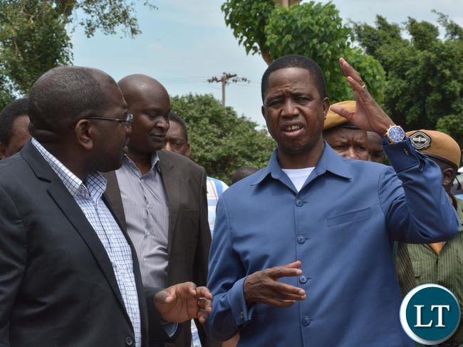President Edgar Lungu(r) chats with Health Minister Chitalu Chilufya(l) after the visit to Kalingalinga Clinic. Picture by Ennie Kishiki/Zanis.
