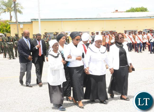 Widow to the late former Deputy speaker of Parliament Mukondo Lungu Doreen Lungu (2nr) at Lusaka City airport before departure to Lundazi for burial