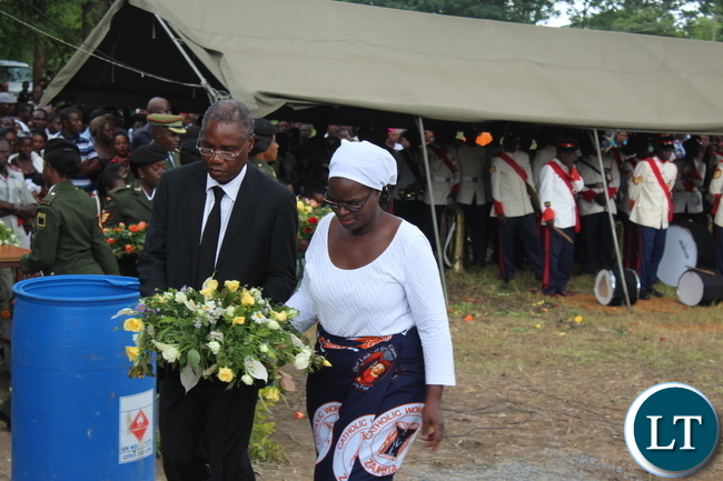 Former Cabinet Minister Emmanuel Chenda with his wife walking over to lay a wreath at the tomb of late Ben Kapita