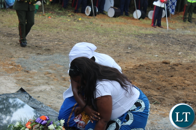 Late Ben Kapita's daughter Patricia being counselled by a family member