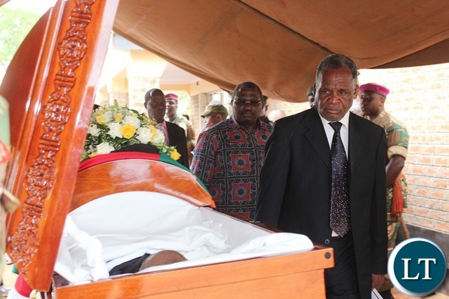 ELDER brother of the late Mkhondo Lungu, Japhet, pays his last respect to his brother during the funeral at Kachule farm in Lundazi
