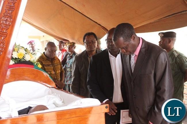 FORMER Lumezi MP, Isaac Banda, pays his last respect to the late Mkhondo Lungu at Kachule farm in Lundazi
