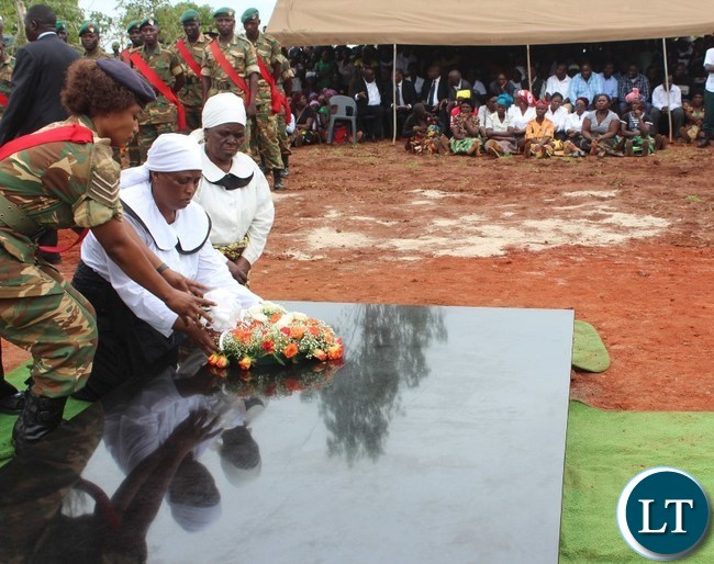 WIDOW of the late Mkhondo Lungu, lays a wreath at the grave of her husband at Kachule farm in Lundazi