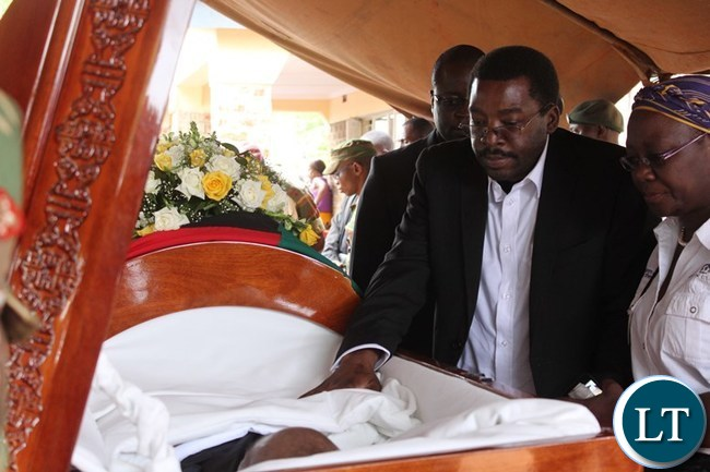 SON of the late former Deputy Speaker of the National Assembly, Mkhondo Lungu, Muhabi, pays his last respect to his father shortly before burial at his farm in Lundazi