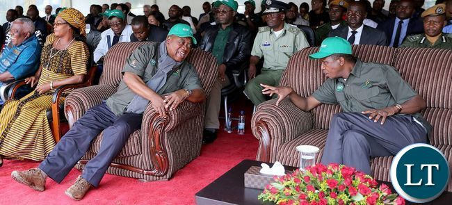 President Lungu chats with former President Rupiah Banda during the tree planting ceremony