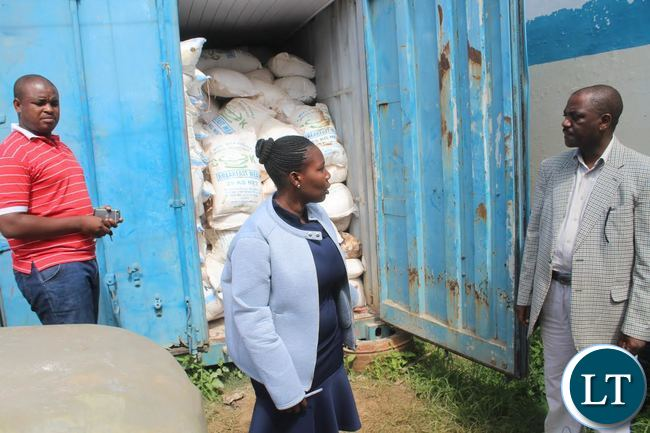 Copperbelt Police Commissioner Charity Katanga inspecting mealie meal destined to be smuggled to neighbouring Democratic Republic of Congo (DRC). By RABECCA CHIPANTA
