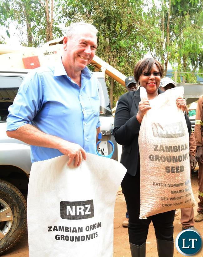 Minister of Agriculture Dora Silaya(r) and Coventry Hawke Coventry Managing Director Chris Hawke(l) at the Grain Association of Zambia