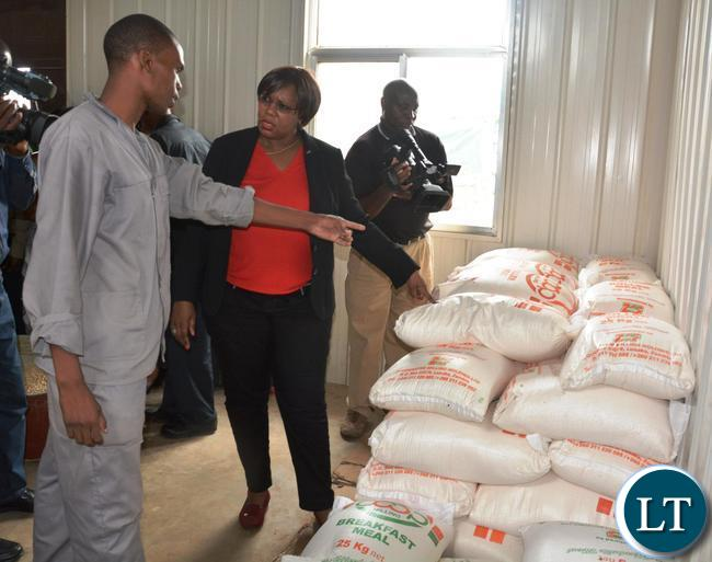 Baulen Milling Plant Sight Supervisor Patrick Mumbi(r) explaining to the Minister of Agriculture Dora Siliya(l) how many bags of Meal Meal they produce pay day,This was when the Minister toured the solar milling plant