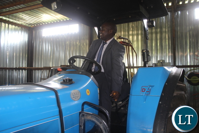 Southern Province Minister Dr Edify Hamukale tries the new tractor acquired by Monze District Dairy Farmers Cooperative Society with support from Netherlands Development Organisation (SNV) and the Czech Republic.