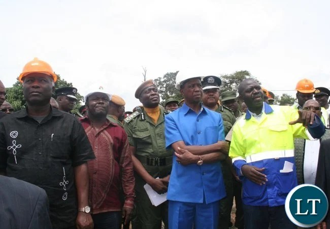 President Lungu being shown a police station under constructon