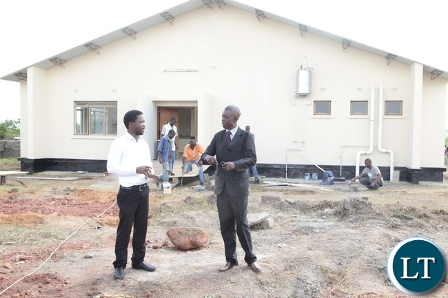 Mkushi District Commissioner Luke Mwamba (right) talking to Mkushi district hospital Health Director Dr Mackford Chipili after touring the newly built hospital in Mkushi