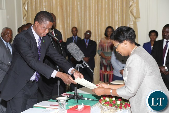 President Edgar Lungu congratulate newly appointed Permanent Secretary in the Ministry of Tourism and Arts Dr.Liya Mutale during the Swearing in Ceremony at State House