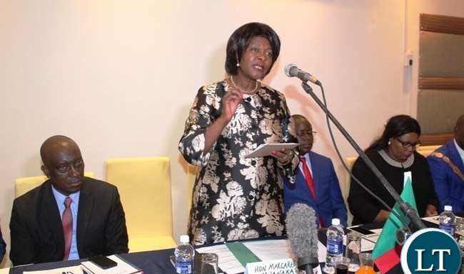 COMERCE Minister, Margaret Mwanakatwe, speaking during the first Eastern Province Symposium on development held at Protea Hotel in Chipata on Thursday. On her right is Luapula Province Minister, Nixon Chilangwa and on her left are Eastern Province Minister, Makebi Zulu and Agicultural Minister, Dora Siliya. PICTURE BY STEPHEN MUKOBEKO/ZANIS