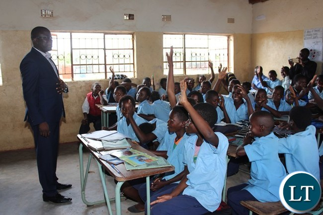 EASTERN Province Minister, Makebi Zulu, interacts with pupils at Kampini Primary School at Chanida border post in Chadiza district on Tuesday. The Minister was on his familiarization tour of the district. PICTURE BY STEPHEN MUKOBEKO/ZANIS