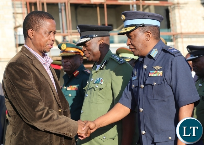 President Edgar Lungu shake hands with Zambia Air Force Major General Deputy Commander David Muma during his departure to Muchinga Province at City Airport in Lusaka