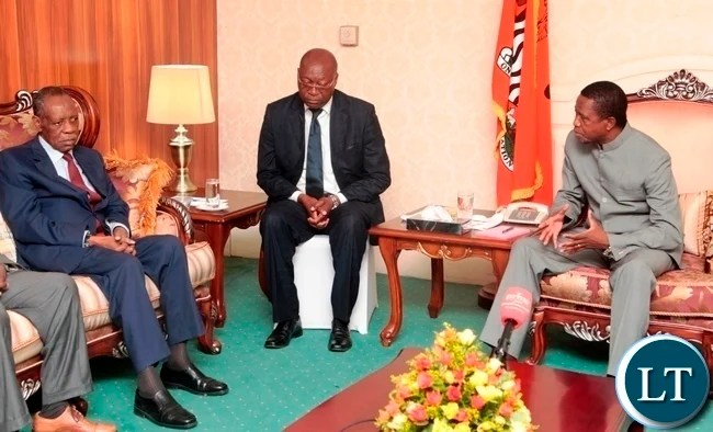 President Edgar Lungu speaks to CAF President Issa Hayatou at State House when he called on the President Lungu