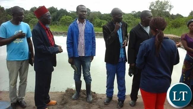 Senior Chief Mwamba of the Bemba people with  his subjects
