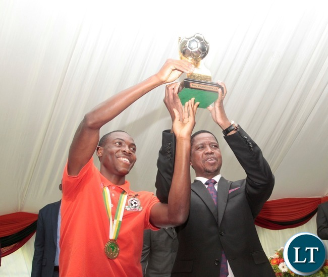 President Edgar Lungu and Zambia Under 20 captain Enock Mwapu hoist the African Cup of Nation in Victory of the 2017 championship at State House yesterday 15-03-2017. Picture by ROYD SIBAJENE/ZANIS
