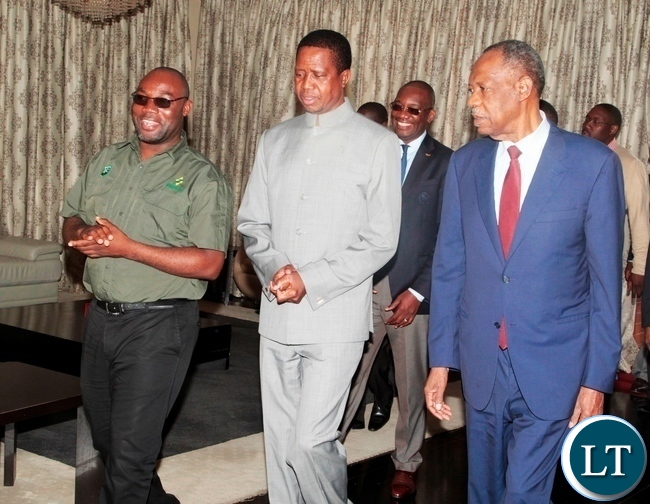 Youth and Sports Minister chats with President Edgar Lungu (c) CAF President Issa Hayatou (r) at State House