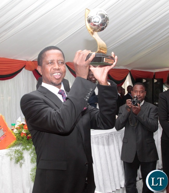 President Edgar Lungu hoist the African Cup of Nation cup won by Zambia Under 20 Nation team at State House yesterday 15-03-2017. Picture by ROYD SIBAJENE/ZANIS